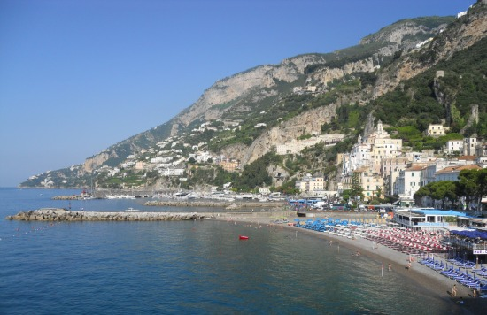 Amalfi harbor lined with restaurants