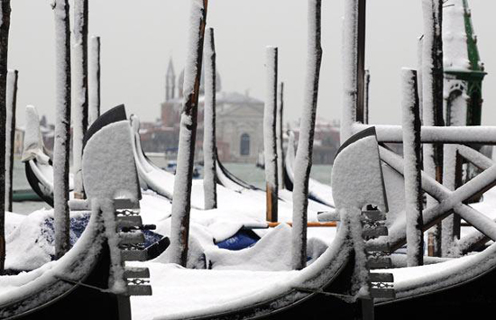 Snow-capped gondolas. Photo credit: EPA