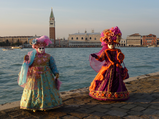 Venice Carnival 2012, (Foreground) Masqueraders on the island of San Giorgio, (Background) Piazza San Marco, Photo credit: Leslie Rosa